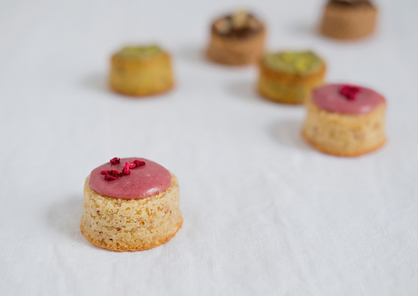 Selection of small canape style almond cakes with icing